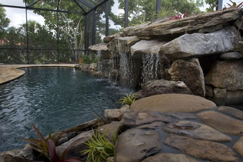 Pool Remodel with Stone Grotto Waterfall and Stone Spa