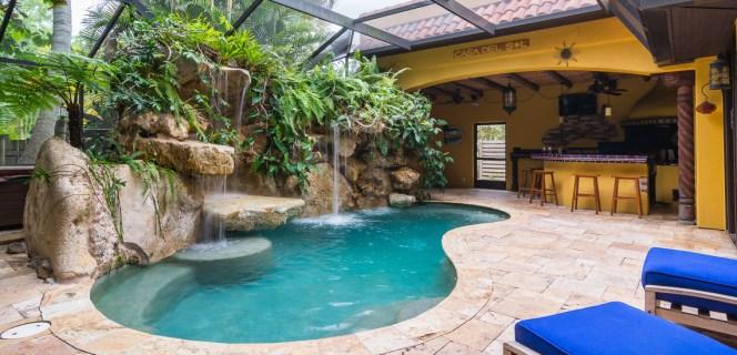 Travertine deck and outdoor kitchen Siesta Key lagoon pool