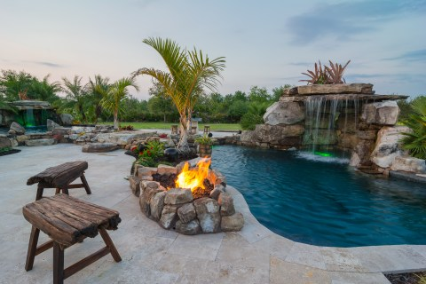 Seating area at Fire Pit and Mai Pool with Stream and Therapy Pool beyond