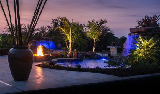 Sunset view of outdoor living space with two lagoon pools