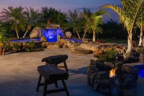 Night time view from fire pit to therapy pool