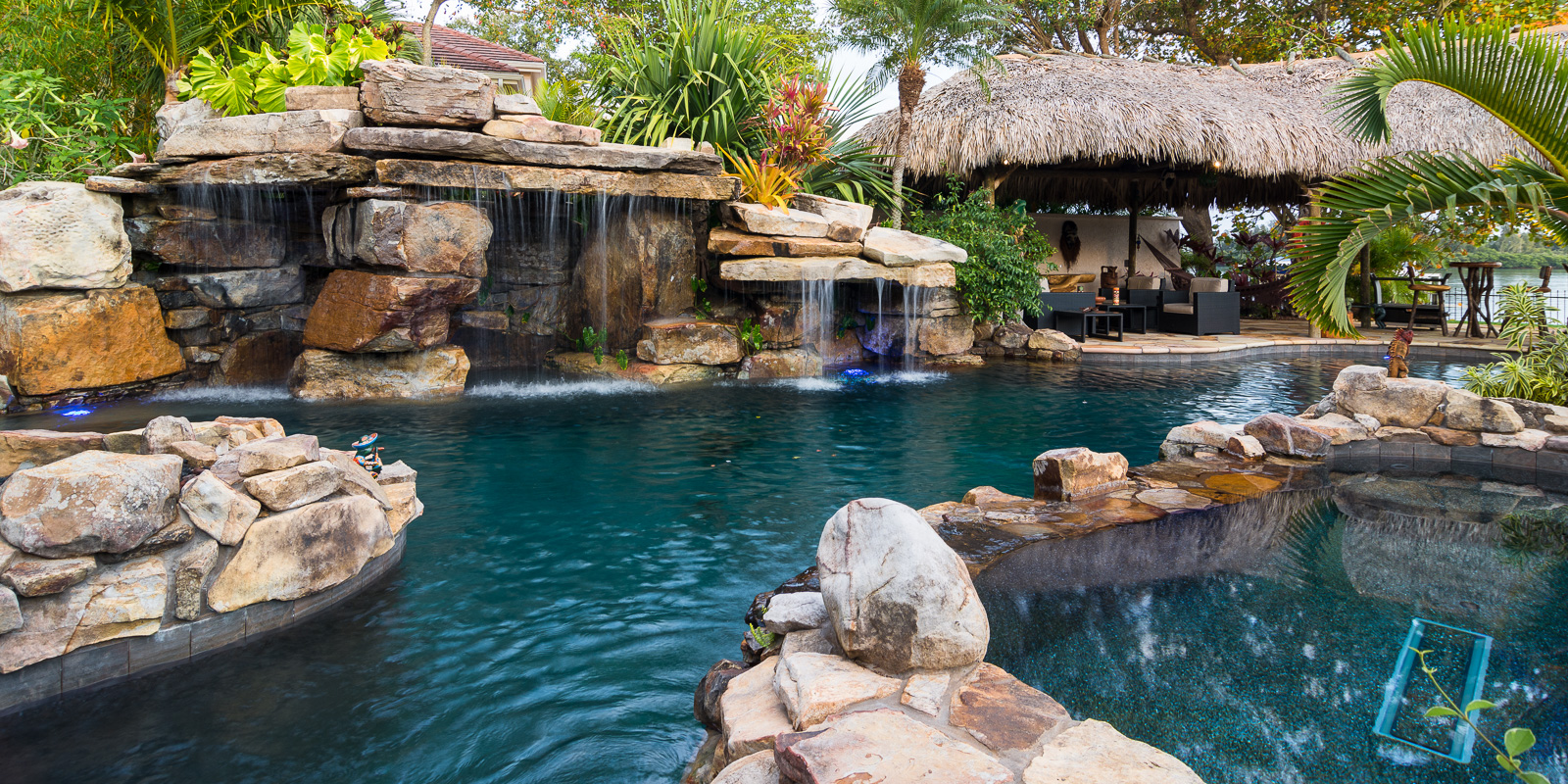 Custom rock waterfall pool grotto spa natural stream for Rock waterfall