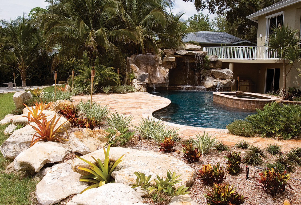 custom swimming pool with natural stone waterfalls and pool grotto pool after - Swimming Pools With Grottos