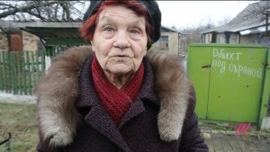 older woman living in wartime Donbas