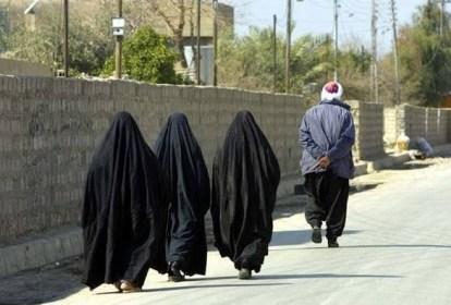 women-walk-behind-men