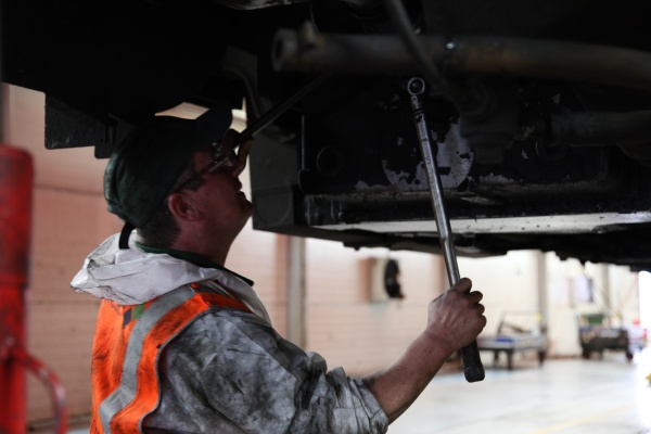 A railworker at work in a depot