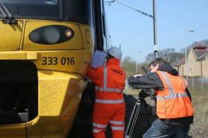 Videographer at work by a train