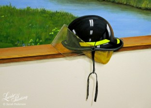 This black fire fighters helmet looks like it is sitting on a wood ledge, but it is all painted on a flat wall with the landscape mural in the background.