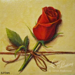 A single red rose is painted on a small canvas that looks like a present with pale yellow coloring. Rose has one 3-leaf branch and appears to be tied on with brown twine in a simple bow.