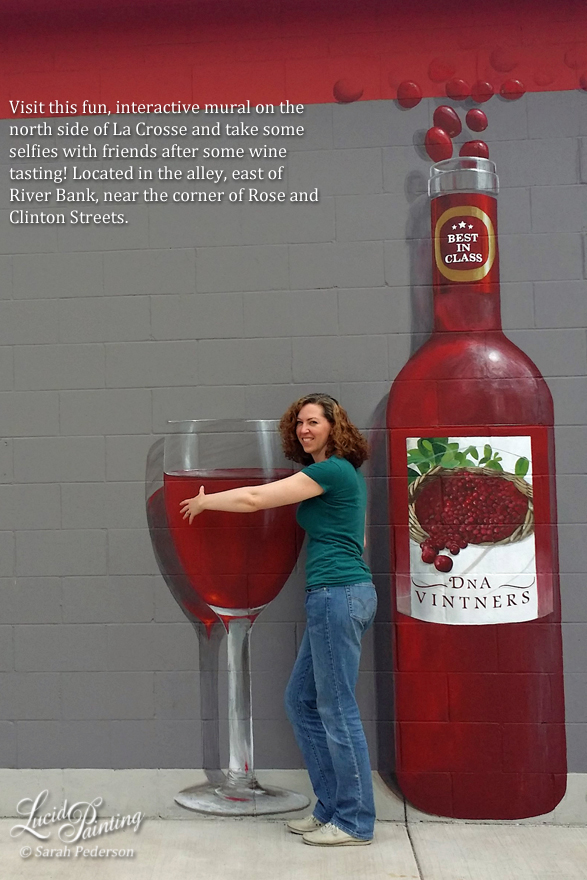Winery mural featuring 9' tall wine bottle and almost 6 foot tall wine glass filled with cranberry wine. Business logo is painted on the bottle, and reflections and shadows add dimension to the mural.