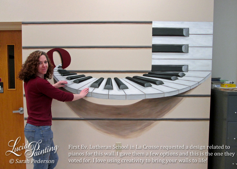 Artist stands in front of a large keyboard that appears to be curved and coming out of the wall. A large shadow is painted below to add to the effect. Keys come out of a whole note and end up placed horizontally on a musical staff.