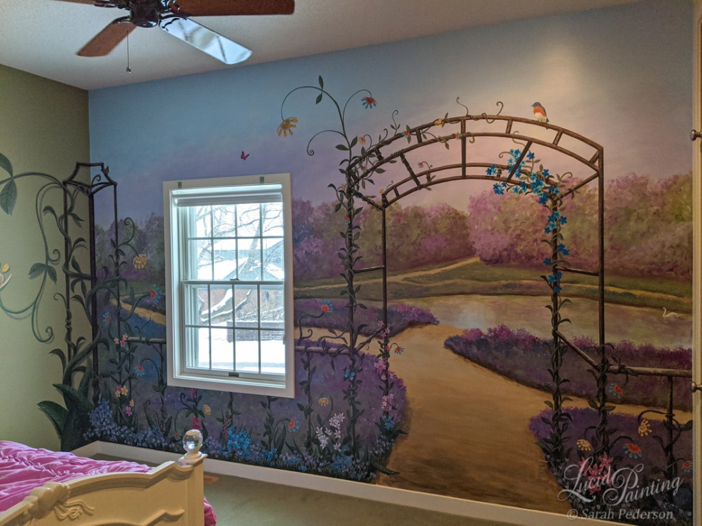 Full wall mural in child's bedroom with a steel arbor and fantasy vines wrapping around a fence and corner trellis. A path circles a pond with a swan, and distant lilac trees add warmth.