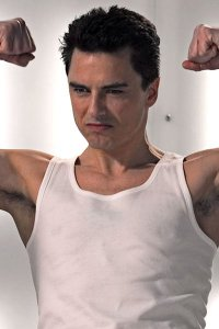 John Barrowman flexing his muscles.