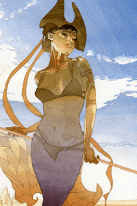 A woman in a tan bikini with an elaborate arm tattoo and staff stands in the desert.