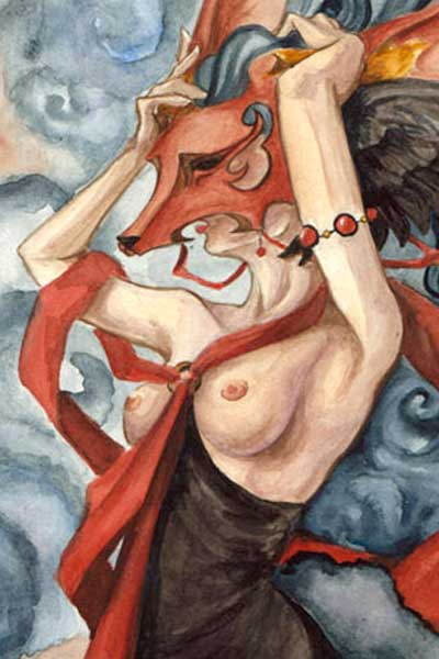 A bare-breasted woman holds a large red canine mask over her head.