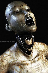A silvery robot woman with engraved casing opens her mouth wide.