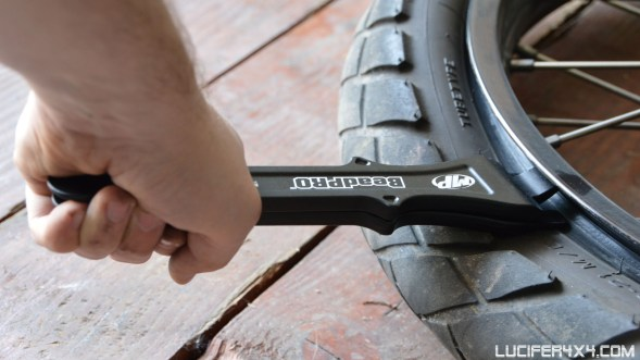Then squize them together and push the tire away from the rim