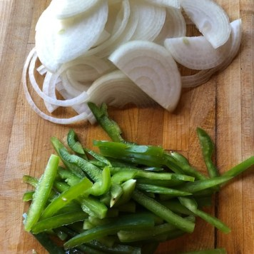 sliced onions and peppers