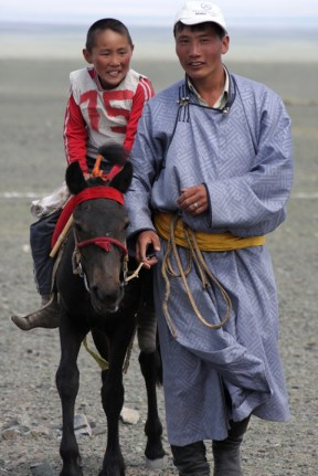 Naadam festival horse race, Chandmani, West Mongolia: father and son