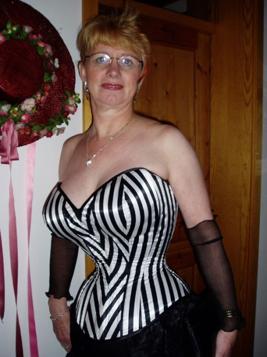 Busty mature in corset