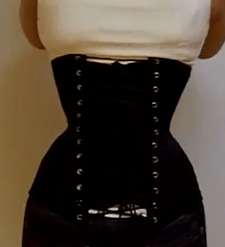 This corset cannot be laced down further due to the underbust and hips. I keep a parallel but wide | | gap down the back.
