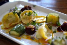hand-made cappelletti, roast zucchini, sumac + curry oil, minced spring garden beets, + pickled mustard seeds