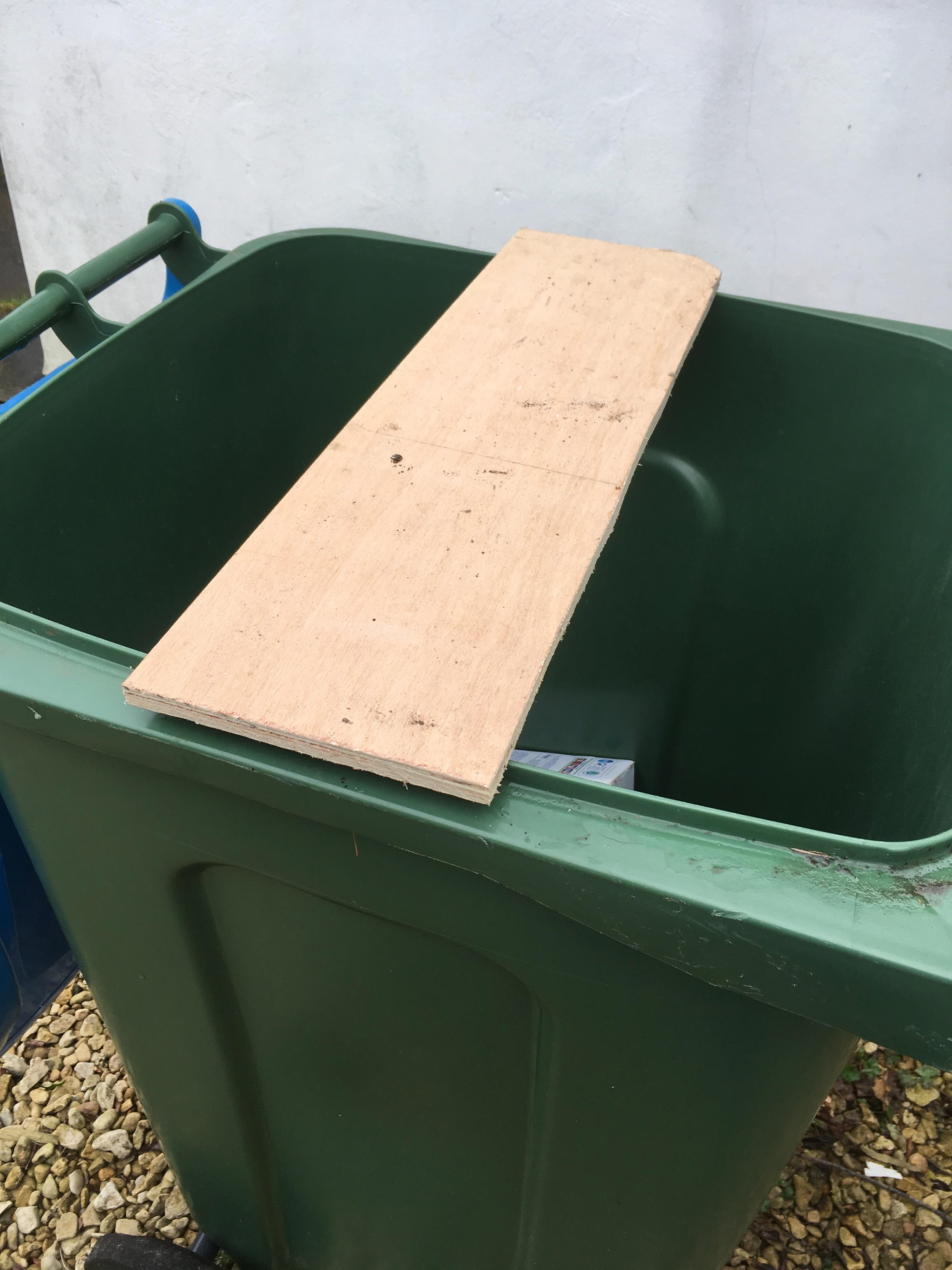 Clamp plywood across bin top