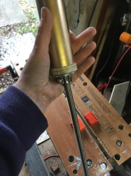 Flange screwed on to a circle of wood, which was screwed on to the key crosspiece.