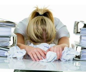 Woman with head on desk - http://lucystanyerlifecoach.com/2016/08/can-i-change-my-…eer-after-thirty a blog post by Lucy Stanyer Life Coach - Can I change my career after 30?