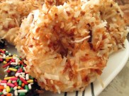 Dunked in vanilla glaze, then tossed in toasted coconut