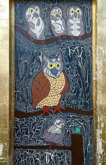 mosaico con gufi