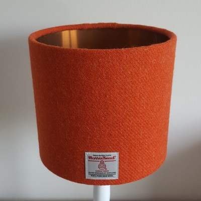 muted orange lampshade with copper lining
