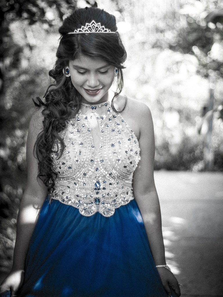 black and white only blue visible on dress quinceanera photography with tiara luis betancourt photography