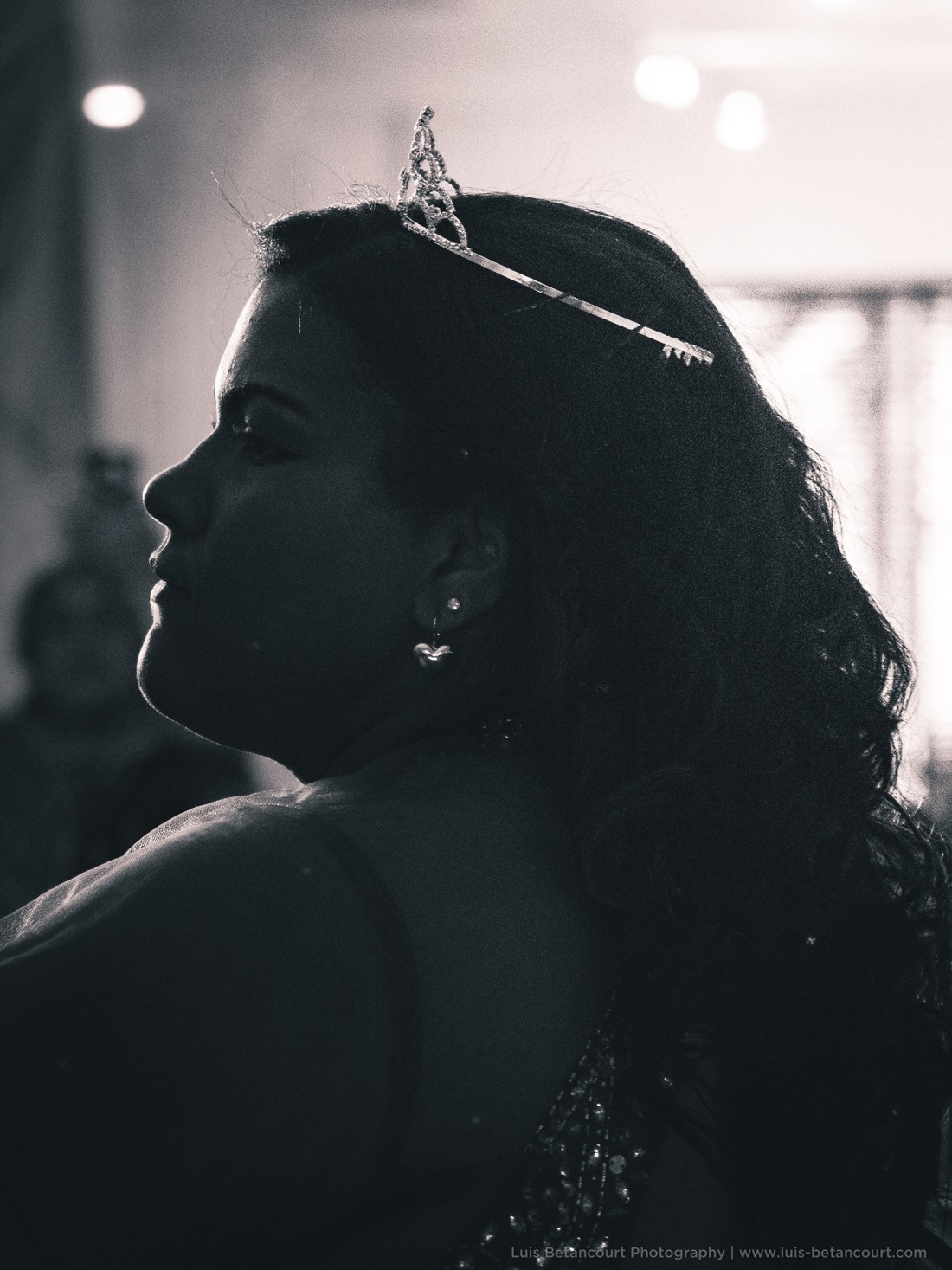 black and white photo of a quinceanera with tiara sideways luis betancourt photography