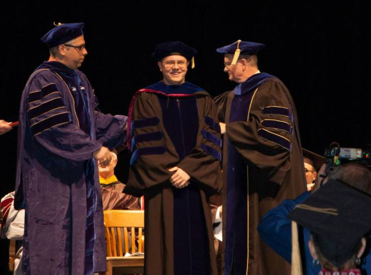 Photo of Student Getting His PhD on stage -- Dr. A's Was his Advisor.