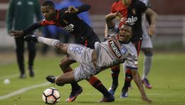Romario Caicedo, right, of Ecuador's Emelec, fights for the ball with Nilson Loyola of Peru's Melgar, during a Copa Libertadores soccer match in Arequipa, Peru, Tuesday, March 14, 2017. (AP Photo/Martin Mejia)