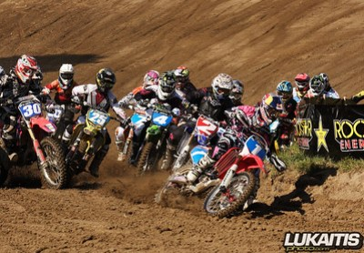 Ashley Fiolek grabs the first moto holeshot while carnage ensues behind her.