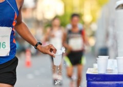 Marathoner grabbing water