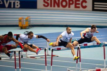 sprinters jumping hurdles