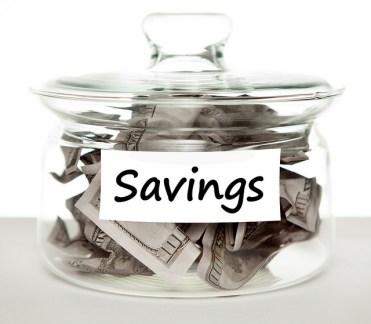 savings jar with $100 bills