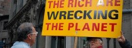 the rich are wrecking the planet sign