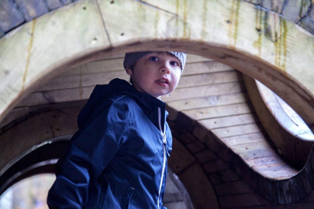 Exploring the giant wooden tunnel sculpture at Alice Holt Forest, Farnham, Surrey. For more, see http://lukeosaurusandme.co.uk