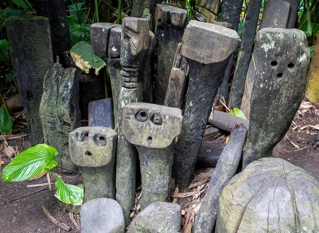 Native rainforest sculptures made of wood that are found in The Eden Project's Rainforest Biome