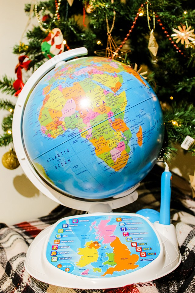 Clementoni Explore The World Interactive Globe in front of a Christmas tree.