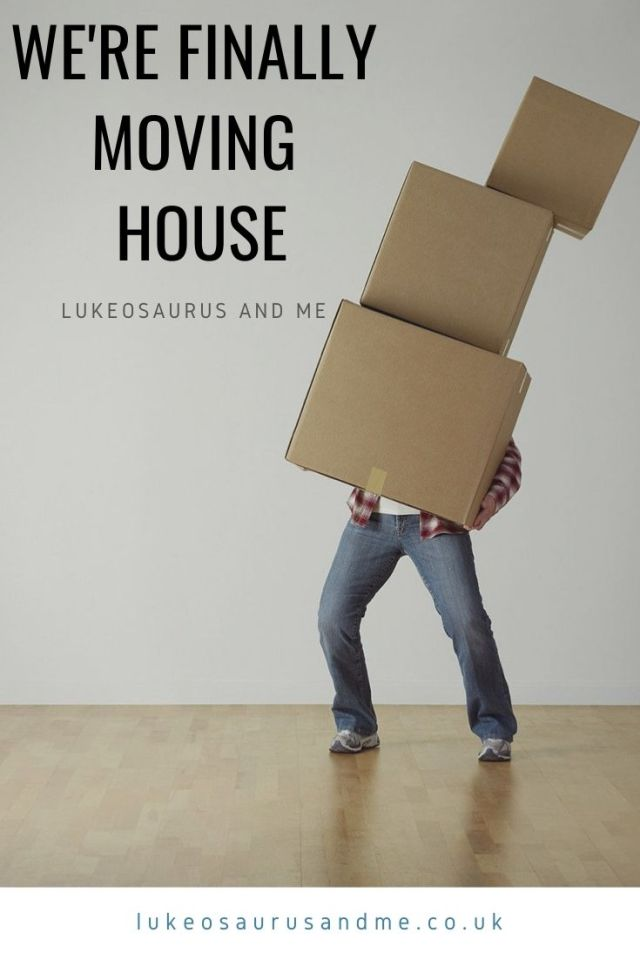 "A man holding a pile of cardboard boxes that are falling over. Black text says ""we're finally moving house"". For a blog post about moving house."