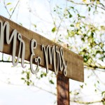 A rustic style wooden sign with the words Mr and Mrs in white