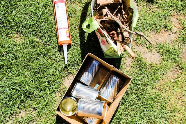 Some silicone, some recycled tin cans and a bag of dead wood, leaves and twigs for a blog post about building a bug hotel.