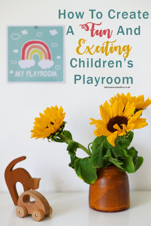 "Sunflowers and some wooden toys with a poster in the background that says 'my playroom'. Text reads ""how to create a fun and exciting children's playroom""."