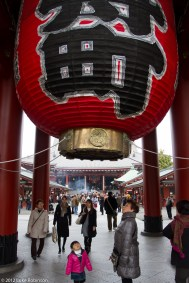 Child looks up at lantern of Hozomon Gate, Senso-ji Temple, Asak