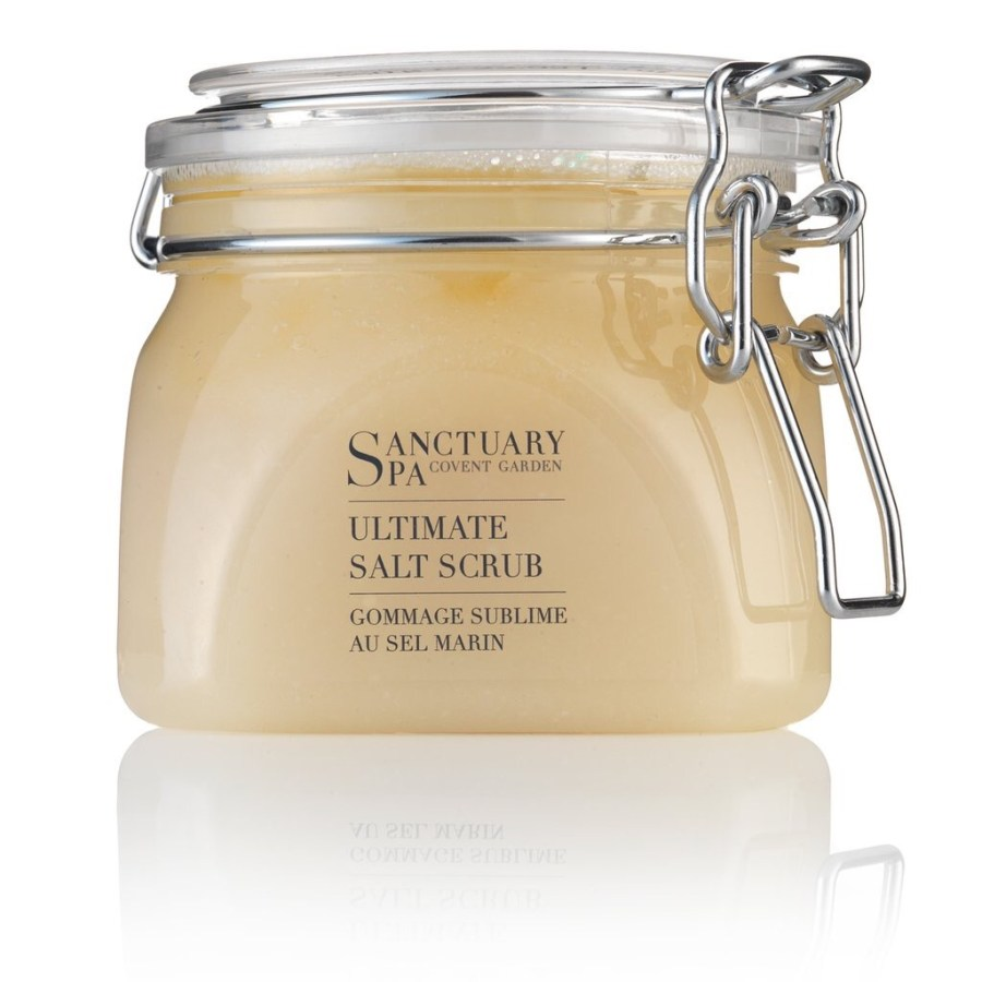 A big glass tub full of Salt scrub with metal clips on the side and labels saying Sanctuary Salt Scrub.